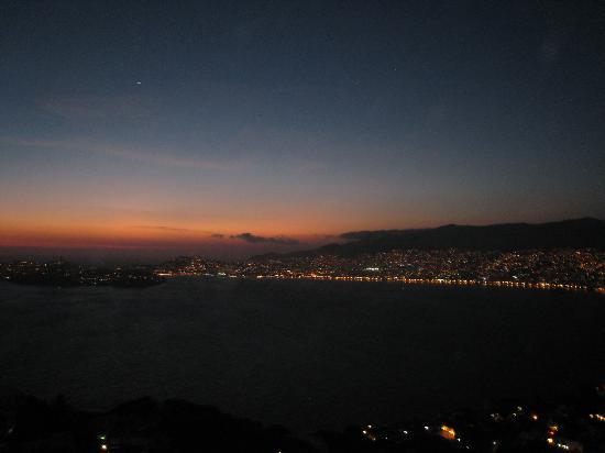 Las Brisas Acapulco: Sunset view from our terrace...old Acapulco is across the Bay