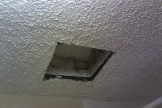 Super 8 Antioch/Nashville South East: Bathroom vent (venting to no where?). No vent cover. Junk falling from the hole.
