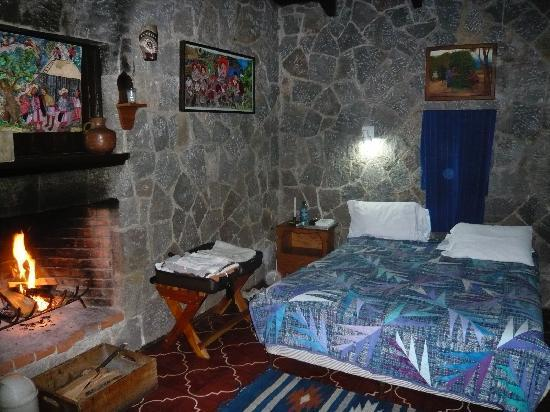 ‪‪Posada de Santiago‬: Cozy stone cottage with fireplace.‬