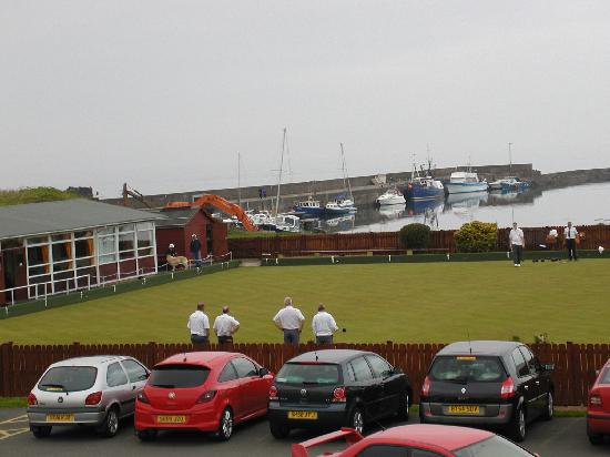 "Girvan, UK: Men playing ""balls"" across from hotel"