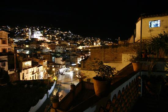 Hotel Posada Santa Anita: The view to the nightly city from the terrace (sitting in outside the room's entrance)