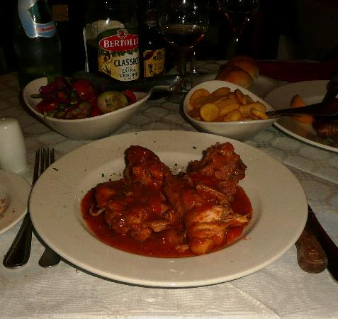Trattoria Palazz: The main of stewed rabbit with accompanying roasted potato slices and simple salad