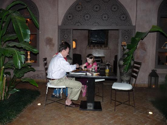 Riad Noir d'Ivoire: Playing chess in one of the courtyards