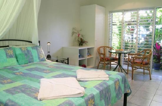 Coral Sea Retreat Bed and Breakfast: Your room opens onto tropical gardens with views of the Coral Sea.