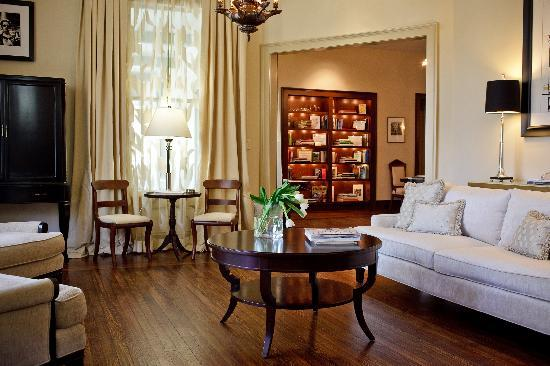 Stonehurst Place: Music Room with Piano and stocked refreshment cabinet