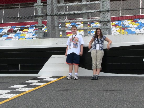 Daytona Beach, FL: Standing on the track at the finish line.