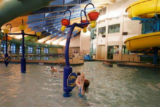 Indoor pool with waterslide  Indoor pool with play features & water slide - Picture of ...