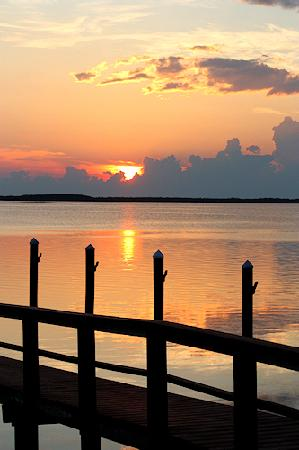 Beso Del Sol Resort: Sunset over dock after a stormy day