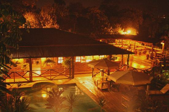 Jasy Hotel: view - room to pool at night