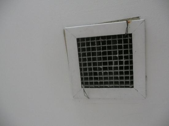 The Hill Apartments: wire holding vent in place