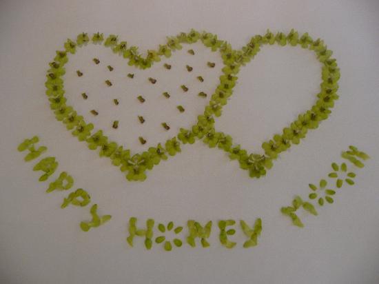The Sarojin Happy Honeymoon Wishes Written In Flowers On Bed