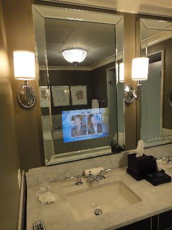 tv behind bathroom mirror restrooms second floor picture of waldorf astoria 21060