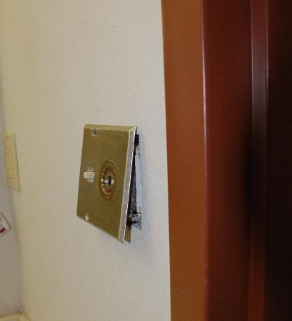 La Quinta Inn Richmond: Lightswitch cover away from wall.