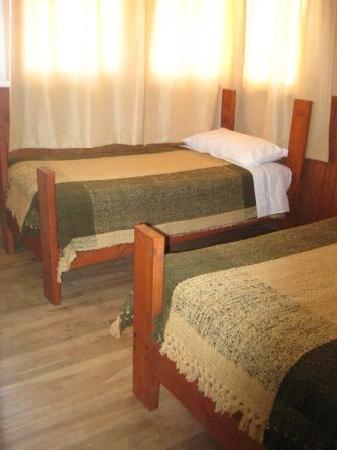 Hostal Coloane: A bedroom