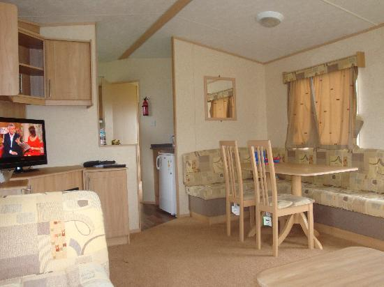 Ashcroft Coast Holiday Park - Park Resorts: the spotless living room, in the gold caravan