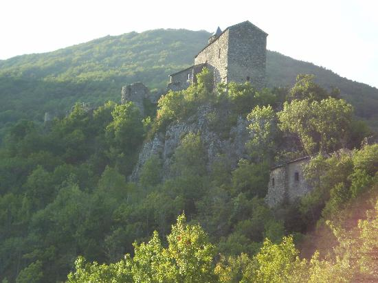 Blanc Sur Sanctus: Looking up to the 10th century church as we hiked down to the river.
