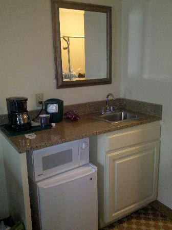 "Country Inn & Suites by Radisson, Asheville at Asheville Outlet Mall, NC: In room ""kitchen"". Microwave and Minifridge"