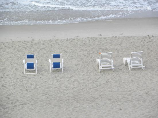 The Inn at Pine Knoll Shores: The two types of chairs for rent. Two chairs, one table and umbrella $15 1 day or $10 for multid