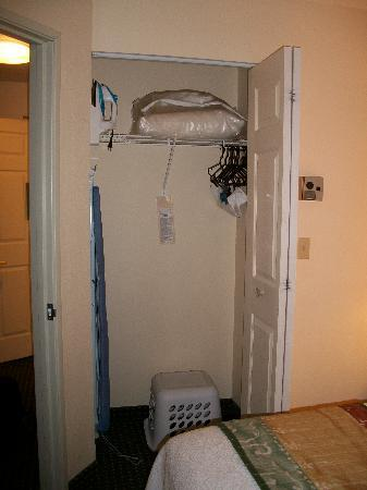 TownePlace Suites Sioux Falls: The bedroom closet that comes with a laundry basket