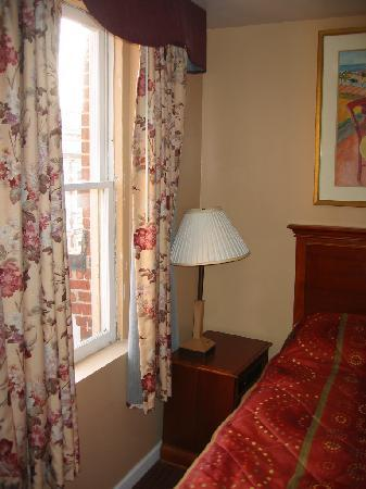 Midtown Inn: Room 118, top floor. Bed so close to wall that nightstand must be sideways with no drawer access