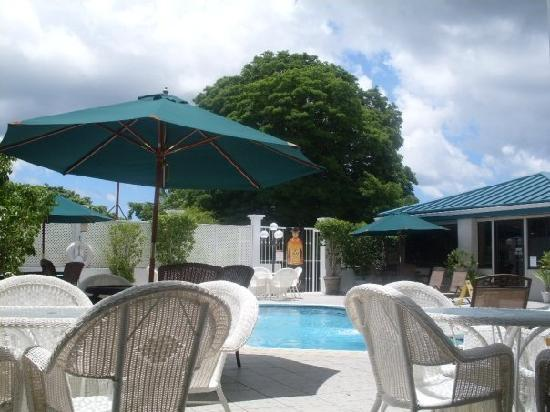 Trade Winds Hotel: pool with restaurant located to further right
