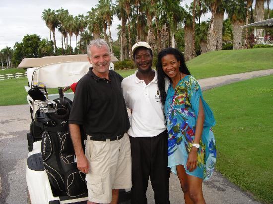Royal Villas at Half Moon: Dave, the caddy and Moya on the Robert Trent Jones Golf Course at Half Moon Jamaica.