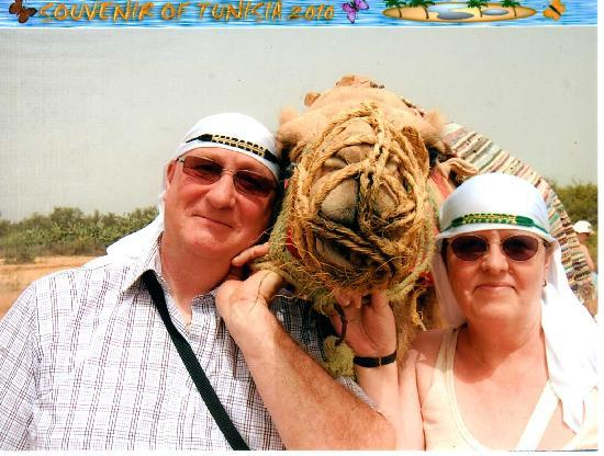 Kaiser Hotel: my wife and I with a camel