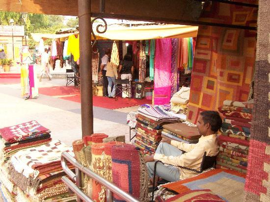 Dilli Haat: A carpet shop-owner spends a leisure moment
