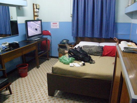 May Fair Hotel: Here is my husband sprawled on the bed in front of the amazing TV