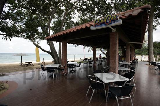 Lotus Desaru Beach Resort : beach side bar, beach hut in background