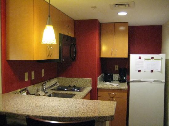 Residence Inn Boston Westborough : The kitchen area - fridge, dishwasher, microwave oven, electric stovetop and utensils all provid