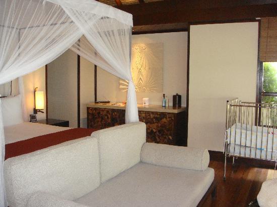 Four Seasons Resort Maldives at Kuda Huraa: sunset beach bungalow bedroom