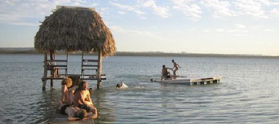 """Tikal Sak Luk Lodge: tourists rest on El Remate's """"love beach"""" on Peten Itza's lake shore"""