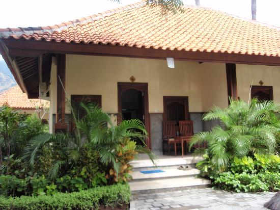 Front of cottage picture of adi assri beach resort spa for Adi perry salon reviews