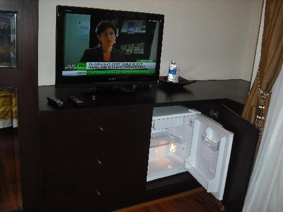 Mirth Sathorn Hotel: Multi-channel TV, one free water, empty fridge