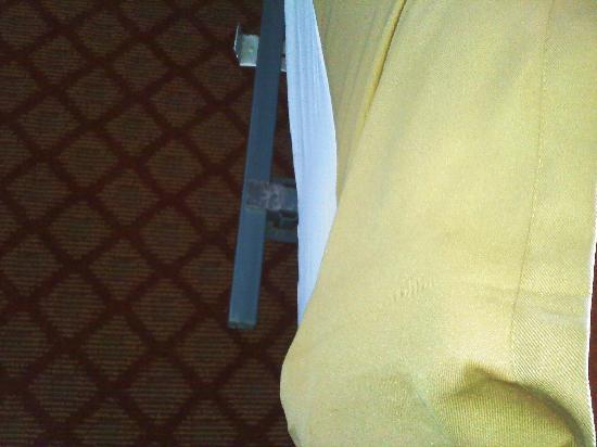Holiday Inn Express Solvang: Bed frame that injured both my wife and I.  How could the staff miss this one?