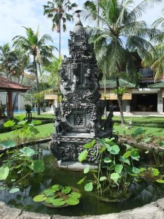 The Cakra Hotel: Central Pond with Restaurant & small pool in the background.