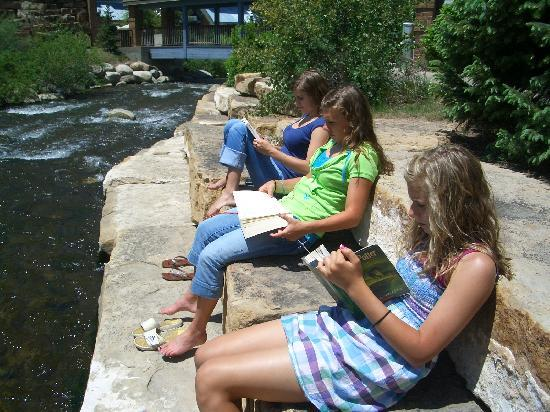 The Lift Condominiums: reading by the creek in Breck.