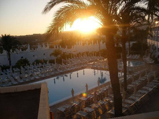 Sunprime Atlantic View: Pool area at sunset.