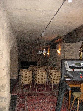 Burghotel: The 'Steinway Cellar' note the gym equipment in the foreground.  Photocopiers and office furnitu