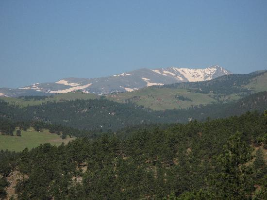 Snow-capped peaks just beyond Boulder