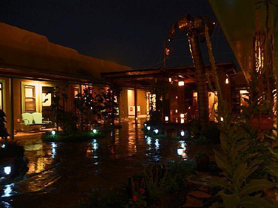 Blackstone Hotsprings Lodging & Baths: Summer thunderstorm in the courtyard