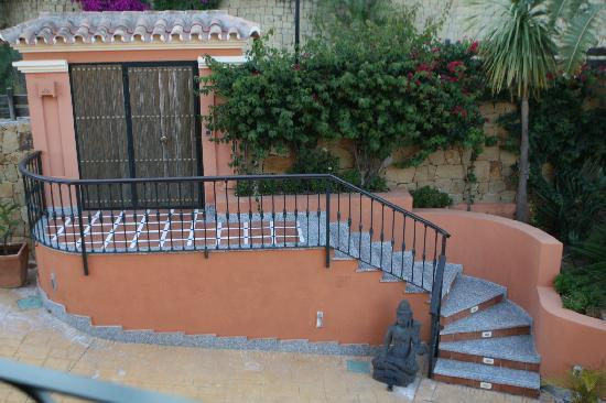 The Marbella Heights Boutique Hotel: A view from inside the home looking at the front walk and front gate.