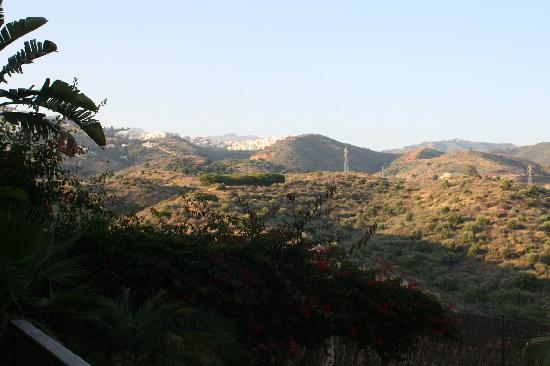 The Marbella Heights Boutique Hotel: The hills.  A camera can't capture the beauty.  Notice a town up the hill.  Cool!
