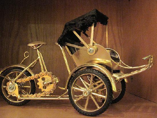 Hanoï, Vietnam : little cyclo as a souvenir bought at a shop in Old Quarters