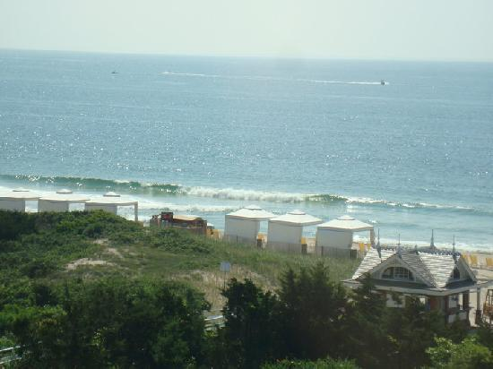 The Ocean House Looking Down Onto Private Beach With Tent Cabanas