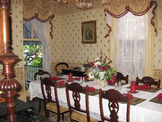 The Harrison: dining room with window open to porch for breakfast