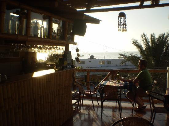 Refugio del Pirata: The third floor patio and bar. You can see the bay in the distance.