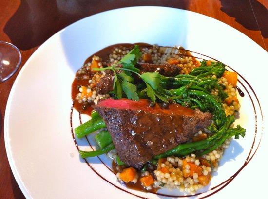 Redwater Rustic Grille - Bow Valley Square : Flat Iron Bison Steak with Couscous risotto & broccolini