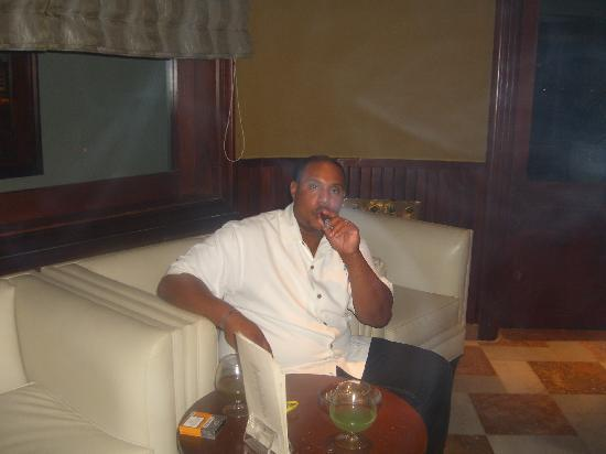 Iberostar Grand Hotel Rose Hall: Hubby in Cigar Bar in the hotel